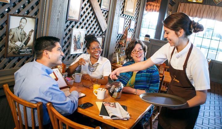 A server helps guests at Cracker Barrel.
