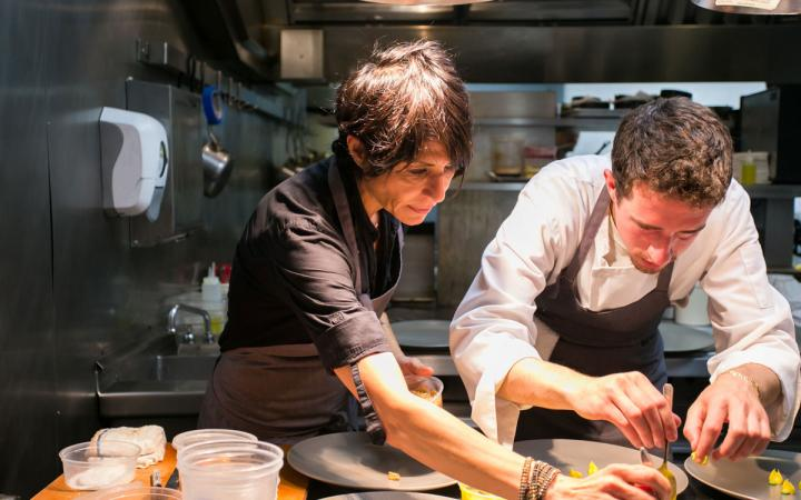 Chef Dominique Crenn works on a plate of her signature cuisine at Atelier Crenn in San Francisco.