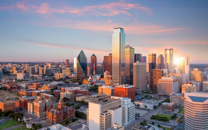 Dallas, Texas cityscape with blue sky at sunset.