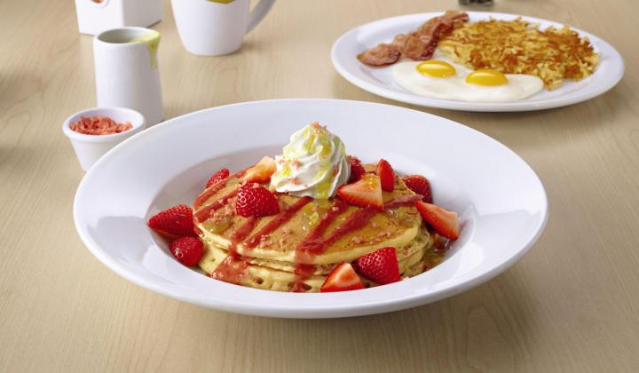 Co-Reactor Pancakes, featuring fresh strawberries, strawberry sauce and whipped cream, plus a side of Crystal Crunch Rocks and a pitcher of warm citrus sauce to pour over the pancakes.
