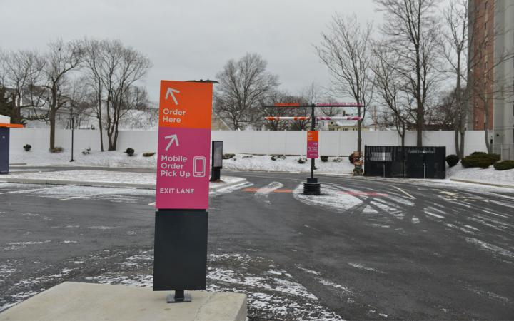 Dunkin' Donuts new drive-thru is shown with double lanes: one for mobile orders and one for regular guests.