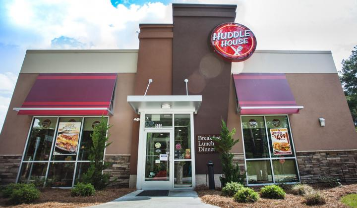 Huddle House's iconic storefront. The restaurant was just sold for an undisclosed amount.