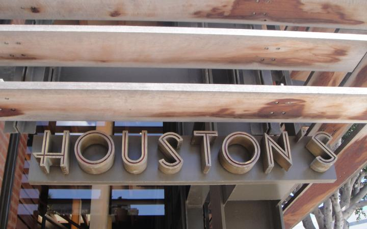 The famous Houston's restaurant sign hangs outside a location.