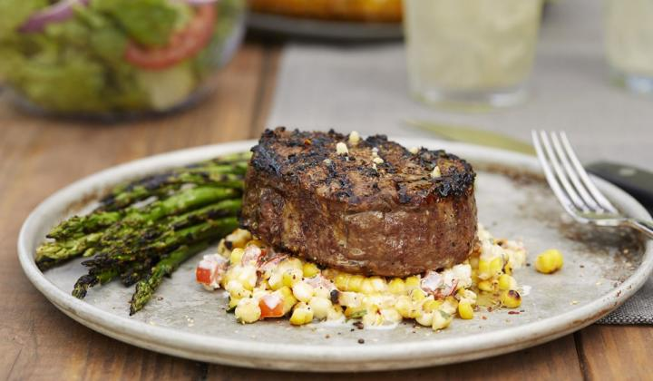 A grilled steak and asparagus at LongHorn restaurant.