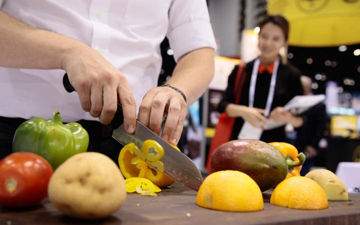 A chef chops vegetables at the National Restaurant Association.