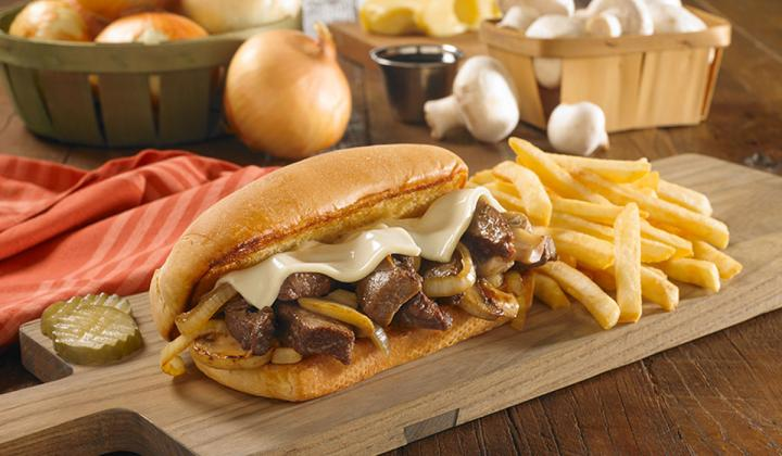 The Prime Rib Tips Sandwich piled high with Huddle House's signature tender Prime Rib Tips.
