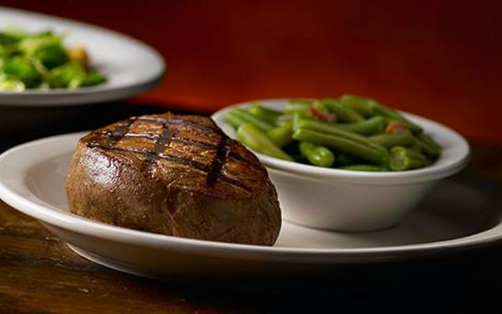 Steak and a side at Texas Roadhouse restaurant.