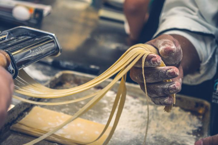 A chef makes pasta by hand.