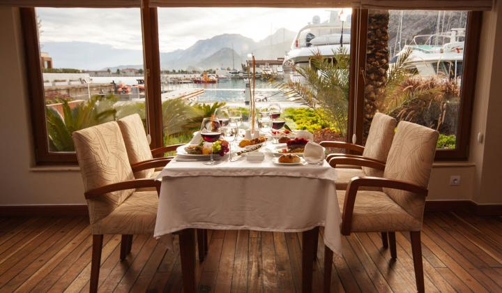 Interior of a restaurant with a view of the water.
