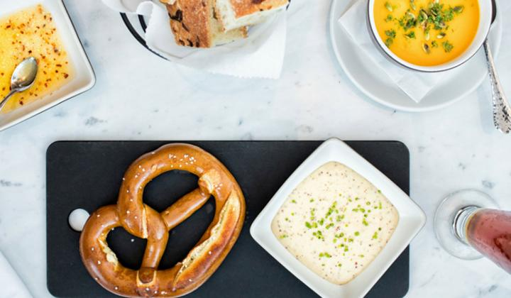 Pretzel and side dishes at Not Your Average Joe's.