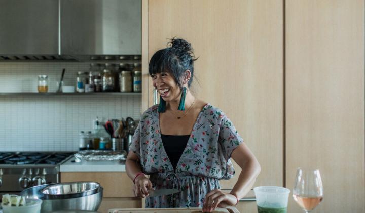 Chef Yana Gilbuena preparing food in a kitchen
