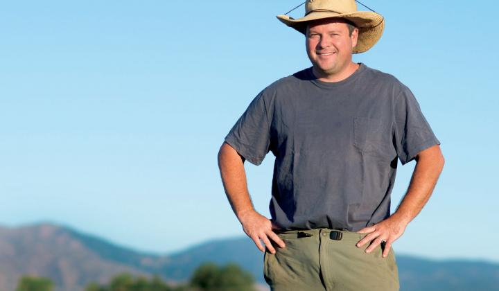 Chef Eric Skokan poses in front of his farm outside Boulder, Colorado.