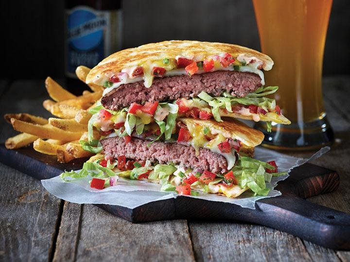 Applebee's Quesadilla Burger is part burger, part quesadilla. This original burger creation comes piled high with Jack cheese, signature Mexi-ranch sauce, crispy bacon, fresh pico and shredded lettuce in a crisp, warm Cheddar quesadilla.