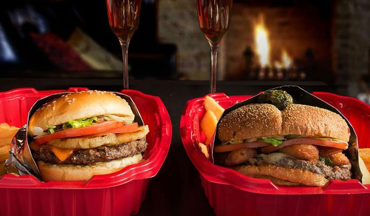 Two burgers and glasses of wine from Red Robin.