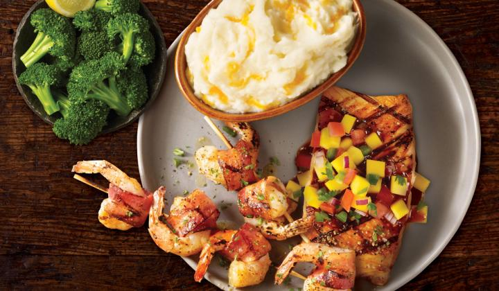Two skewers of three large jumbo shrimp, wrapped in hardwood smoked bacon and brushed with a parmesan butter sauce.