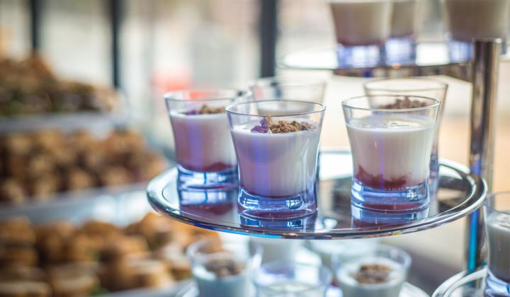 Close up of small catering desserts in a glass.
