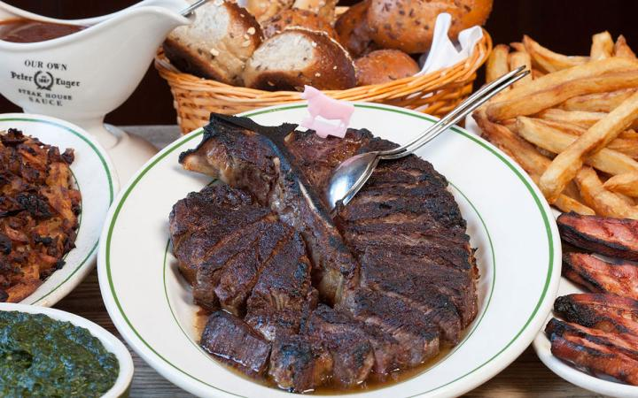 Steak, sides, bacon, and all the fixings at Peter Luger Steakhouse in New York City.