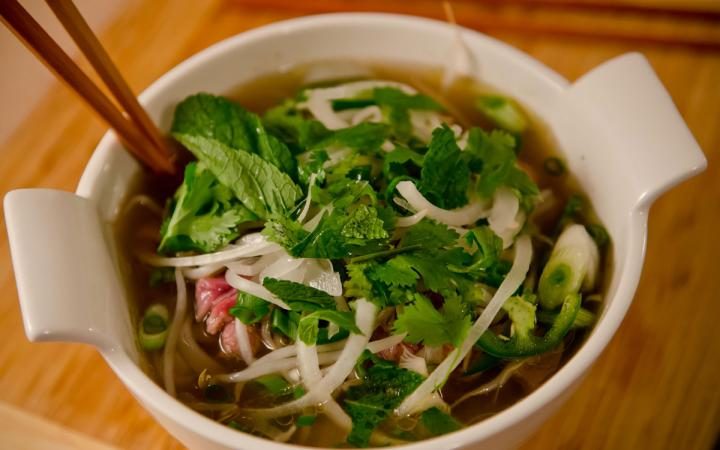 Pho soup prepared, steaming, and ready to eat.