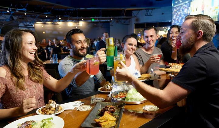 Happy guests share a round of drinks at Big Al's, a a premier family-owned & family-friendly Sports Bar & Entertainment Center, planning for expansion this year.