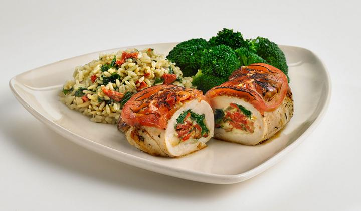 Stuffed Chicken: A 6oz. chicken breast stuffed with peppadew peppers, sun-dried tomato, spinach, and manchego cheese served with Florentine rice and broccoli.