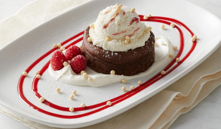 Molten Chocolate Cake with Mascarpone cream, white chocolate raspberry gelato.