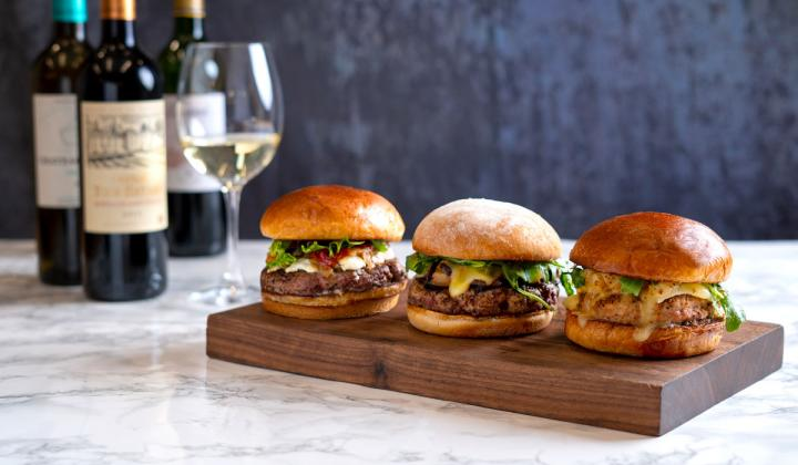 Burgers and wine at Del Frisco's Grille restaurant.