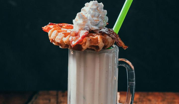 The Frozen Brunch is a vanilla milkshake topped with bacon, a Belgian waffle, maple syrup, powdered sugar and whipped cream.