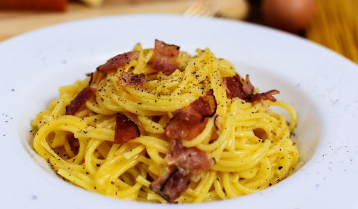 A dish of Carbonara pasta.