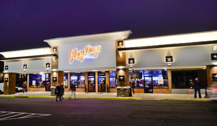 The front of a Glory Days Grill restaurant with guests going inside.