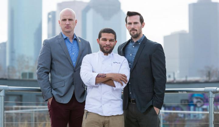 Todd Leveritt, Dominick Lee, Ian Tucker stand in front of the Houston skyline.
