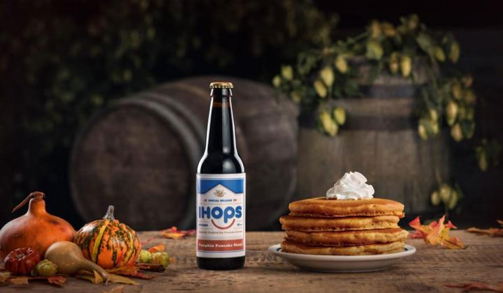 A bottle of IHOPs beer next to pancakes.