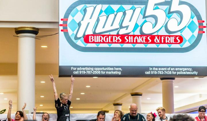Molly Schuyer celebrates after winning the Hwy 55 Burger, Shakes & Fries World Hamburger Eating Championship.