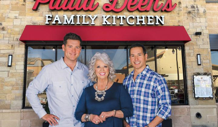 Paula Deen stands with her two sons in front of her new Texas restaurant.