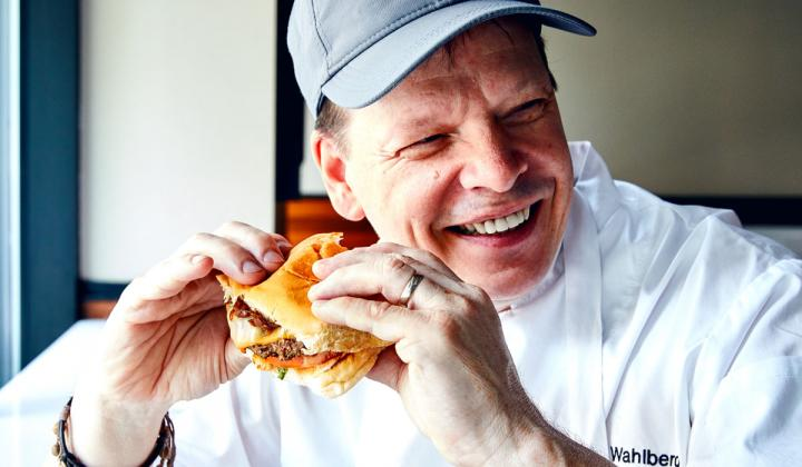 Paul Wahlberg munches down on an Impossible Burger.